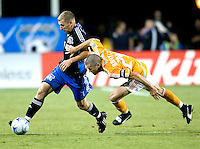 13 September 2008: Ronnie O'Brien of the Earthquakes dribbles the ball away from Wade Barrett of the Dynamo during the game at Buck Shaw Stadium in Santa Clara, California.   San Jose Earthquakes tied Houston Dynamo, 1-1.
