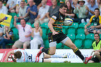 Vasily Artemyev of Northampton Saints leaves the Exeter Chiefs defence in disarray during the Aviva Premiership match between Northampton Saints and Exeter Chiefs at Franklin's Gardens on Sunday 9th September 2012 (Photo by Rob Munro)