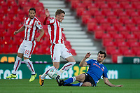 Joe Rafferty of Rochdale tackles Josh Tymon of Stoke City during the Carabao Cup match between Stoke City and Rochdale at the Britannia Stadium, Stoke-on-Trent, England on 23 August 2017. Photo by James Williamson / PRiME Media Images.