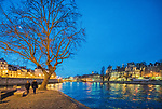 A couple walking by the Seine river on Saint Louis island, Paris, France