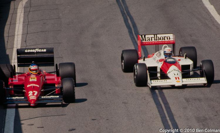 Alain Prost in the McLaren MP4-4 passing Michele Alboreto in the Ferrari F1/87-88C, Detroit 1988