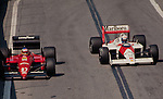 Alain Prost in the McLaren MP4-4 passing Michele Alboreto in the Ferrari F1/87-88C, Detroit 1988