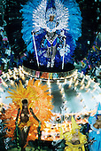 Rio de Janeiro, Brazil. Carnival; man in sequin and feather costume on a float with female samba dancers.