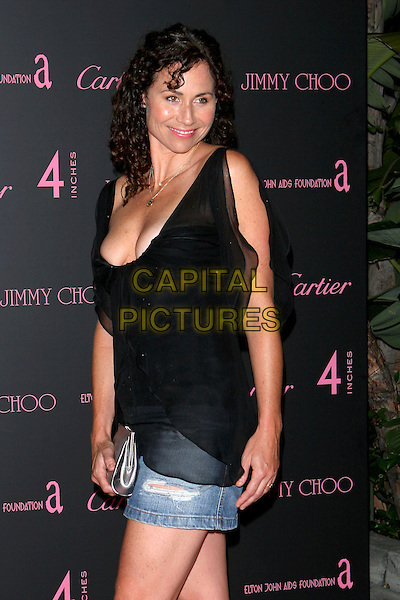 "MINNIE DRIVER.""4 Inches - A project for women, about women, by women"" Book Launch and photographic auction to benefit the Elton John Aids Foundation held at Morton's, West Hollywood, CA, USA, .21 June 2005..half length black top low cut cleavage denim mini skirt.Ref: ADM.www.capitalpictures.com.sales@capitalpictures.com.©Jacqui Wong/AdMedia/Capital Pictures."