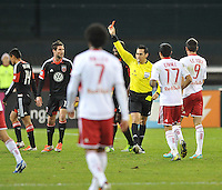 D.C. United midfeilder Andy Najar (14) gets a red card from referee Jair Marrufo.  The New York Red Bulls tied D.C. United 1-1 in the first leg of the Eastern Conference semifinals at RFK Stadium, Saturday November 3, 2012.