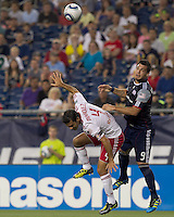 New York Red Bulls defender Rafa Marquez (4) and New England Revolution forward Milton Caraglio (9) battle for head ball. In a Major League Soccer (MLS) match, the New England Revolution tied New York Red Bulls, 2-2, at Gillette Stadium on August 20, 2011.