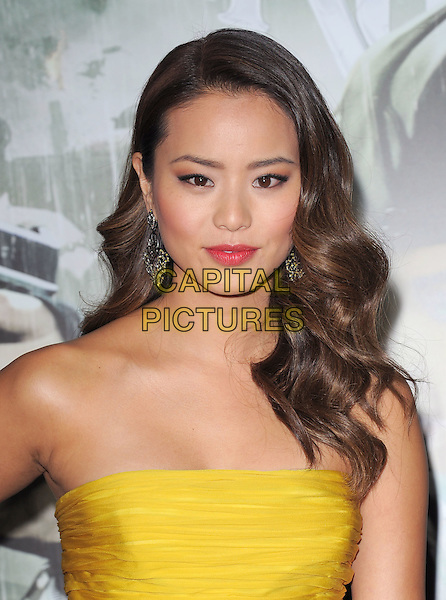 "JAMIE CHUNG .at The Warner Bros. Pictures World Premiere of ""Sucker Punch"" held at The Grauman's Chinese Theatre in Hollywood, California, USA,.March 23rd 2011..portrait headshot strapless yellow make-up  earrings beauty wavy hair lipstick .CAP/RKE/DVS.©DVS/RockinExposures/Capital Pictures."