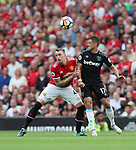 Manchester United's Phil Jones tussles with West Ham's Javier Hernandez during the premier league match at Old Trafford Stadium, Manchester. Picture date 13th August 2017. Picture credit should read: David Klein/Sportimage