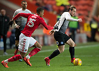 Jack Marriott of Peterborough United goes past Ezri Konsa of Charlton Athletic during the Sky Bet League 1 match between Charlton Athletic and Peterborough at The Valley, London, England on 28 November 2017. Photo by Vince  Mignott / PRiME Media Images.