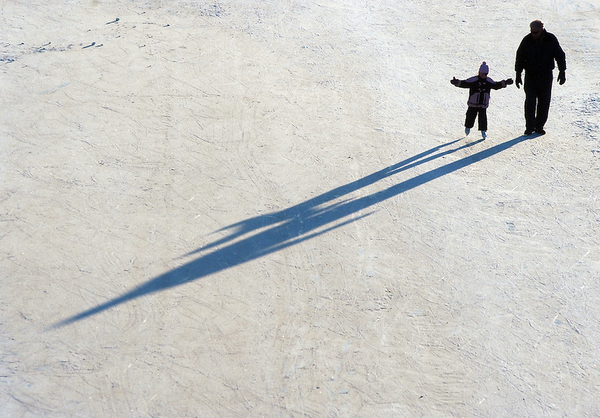 The setting sun casts long shadows in front of Leah Ashby and her father Ray Ashby as the two make their way around the speedskating oval in the Wakamow Valley. MARK TAYLOR/Moose Jaw Times-Herald