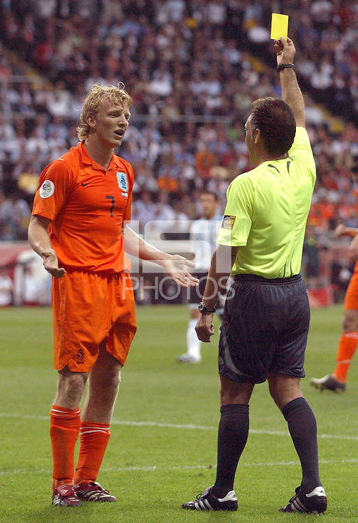 Netherland's Dirk Kuyt (7) is given a yellow card by referee Medina Cantalejo. Argentina and the Netherlands played to a 0-0 draw in their FIFA World Cup Group C match at FIFA World Cup Stadium, Frankfurt, Germany, June 21, 2006.