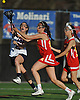 Katie Hudson #21 of Cold Spring Harbor, left, gets off a shot while pressured by Audrey Mandaro #15, center, and Melissa Biscardi #27 of Sacred Heart during a non-league varsity girls lacrosse game at Cold Spring Harbor High School on Friday, Apr. 1, 2016. Cold Spring Harbor won by a score of 11-9.