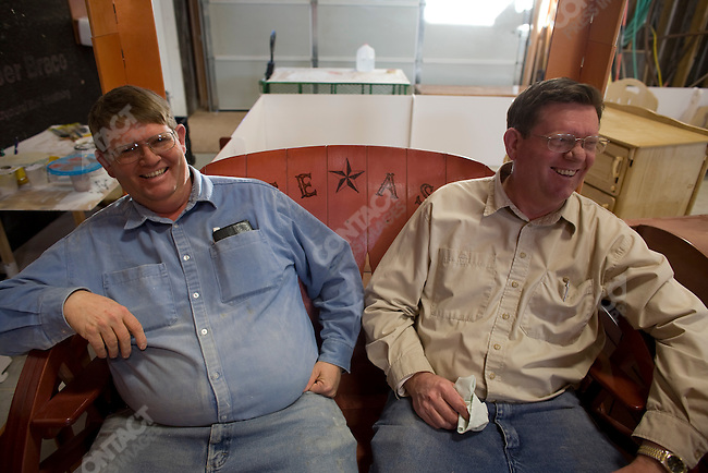 """Fundamentalist Mormon group F.L.D.S.,  Edson Jessop (right) working in the wood shop """"Yearning for Zion"""" compound in Eldorado, Texas, USA, February 11, 2009"""