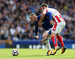 Everton's Wayne Rooney tussles with Stoke's Erik Pieters during the premier league match at Goodison Park, Liverpool. Picture date 12th August 2017. Picture credit should read: David Klein/Sportimage