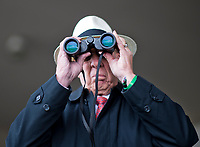 LOUISVILLE, KY - MAY 06: A man uses binoculars to watch a race on Kentucky Derby Day at Churchill Downs on May 6, 2017 in Louisville, Kentucky. (Photo by Douglas DeFelice/Eclipse Sportswire/Getty Images)