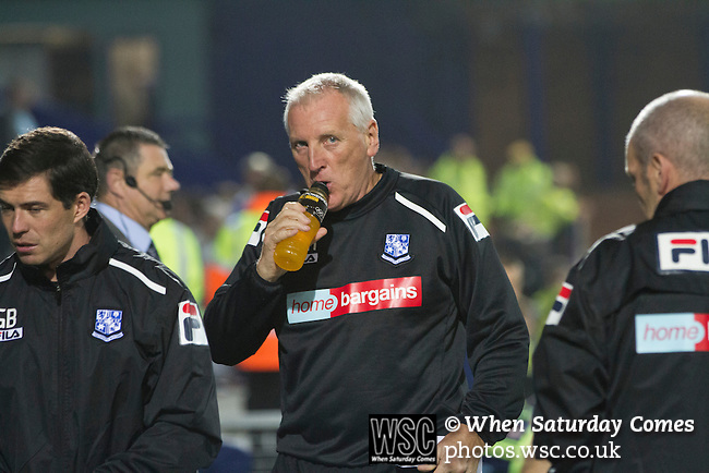 Tranmere Rovers 0 Stoke City 2, 25/09/2013. Prenton Park, Captial One Cup Third Round. Home team manager Ronnie Moore drinking from a bottle as he makes his way to the dugout at Prenton Park before Tranmere Rovers host Stoke City in a Capital One Cup third round match. The Capital One cup was formerly known as the League Cup and was competed for by all 92 English Premier League and Football League clubs. Visitors Stoke City won the match 2-0, watched by a crowd of 5,559 spectators. Photo by Colin McPherson.