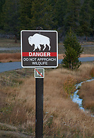 A Do Not Approach Wildlife Sign warns tourists of the dangers of feeding or approaching wildlife too closley, Yellowstone National Park, Wyoming