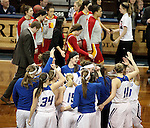 SIOUX FALLS MARCH 22:  Grand Valley State celebrates their 59-56 win as Pittsburg State University walks off the floor of their quarterfinal game at the NCAA Women's Division II Elite 8 Tournament at the Sanford Pentagon in Sioux Falls, S.D. (Photo by Dave Eggen/Inertia)