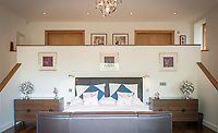 BNPS.co.uk (01202 558833)<br /> Pic: MrAndMrsClarke/BNPS<br /> <br /> Bedroom. <br /> <br /> A luxury house on an English country estate where the Allies plotted the infamous assassination of one of Adolf Hitler's top henchmen has gone on the market.<br /> <br /> Rooftops, a Norwegian-style chalet, is located on the Moreton Paddox estate in Warwickshire where 4,000 Czech soldiers were billeted during the Second World War.<br /> <br /> The plot to assasinate Nazi monster SS General Reinhard Heydrich involved two Czech soldiers who parachuted into Prague where they attacked and killed him as he was driven to work. <br /> <br /> His death led to appalling Nazi reprisals on locals, with more than 1,300 men, women and children massacred.<br /> <br /> The Edwardian mansion at Moreton Paddox that was requisitioned for the war effort was later demolished and Rooftops was built on the grounds in 2009.