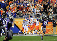 Jan. 4, 2010; Glendale, AZ, USA; Boise State Broncos cornerback (13) Brandyn Thompson is congratulated after returning an interception for a touchdown in the first quarter against the TCU Horned Frogs in the 2010 Fiesta Bowl at University of Phoenix Stadium. Mandatory Credit: Mark J. Rebilas-