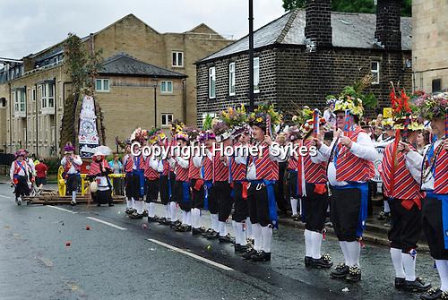 Uppermill, Saddleworth, Yorkshire Uk. Saddleworth Rushcart and Morris men leaving The Commercial pub.