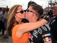 Apr 26, 2008; Talladega, AL, USA; NASCAR Sprint Cup Series driver A.J. Allmendinger kisses his wife Lynne Kush during qualifying for the Aarons 499 at Talladega Superspeedway. Mandatory Credit: Mark J. Rebilas-