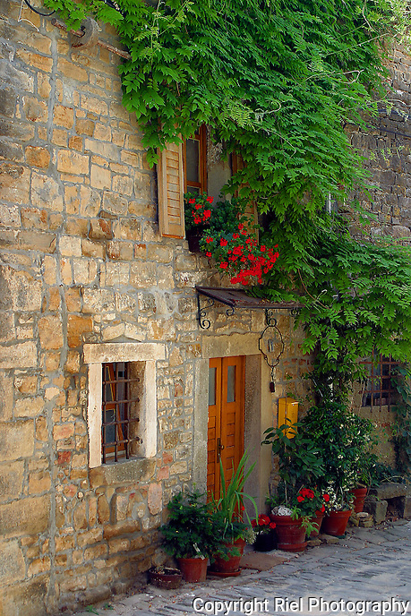 "The Isterian Hill Towns of Croatia are being hailed as the ""new"" Tuscany. This is one of many pretty street scenes found in these fortress towns."