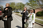 April 15, 2008. Wallace, NC..Funeral services were held for National Guard Staff Sgt. Emanuel Pickett at the 1st Baptist Church in Wallace, NC., where he was a police officer.. SSgt. Pickett was killed on April 6, 2008 in Baghdad, Iraq by indirect enemy fire. He was assigned to the 1132nd Military Police Company, North Carolina Army National Guard, Rocky Mount, N.C. and is the 8th North Carolina National Guard soldier killed in the wars in Iraq and Afghanistan.. Community members watch as SSgt. Pickett's casket is brought out of the church.