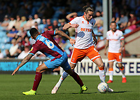 Blackpool's Antony Evans gets past Scunthorpe United's Funso Ojo<br /> <br /> Photographer David Shipman/CameraSport<br /> <br /> The EFL Sky Bet League One - Scunthorpe United v Blackpool - Friday 19th April 2019 - Glanford Park - Scunthorpe<br /> <br /> World Copyright © 2019 CameraSport. All rights reserved. 43 Linden Ave. Countesthorpe. Leicester. England. LE8 5PG - Tel: +44 (0) 116 277 4147 - admin@camerasport.com - www.camerasport.com