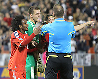 Julian de Guzman #6, Milos Kocic #30 and Nick Garcia #4 of Toronto FC argue a penalty kick decision by referee Silviu Petrescu during an MLS match against D.C. United that was the final appearance of D.C. United's Jaime Moreno at RFK Stadium, in Washington D.C. on October 23, 2010. Toronto won 3-2.