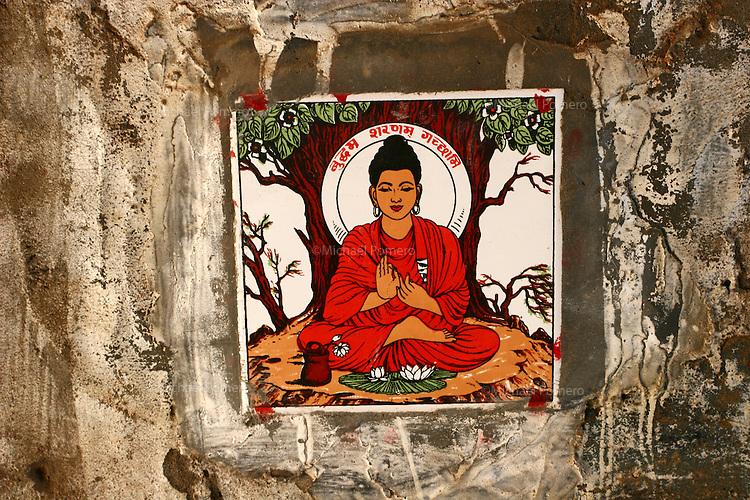 28.10.2007 Varanasi(Uttar Pradesh)<br /> <br /> Buddha in a street wall.<br /> <br /> Buddha sur un mur de rue.