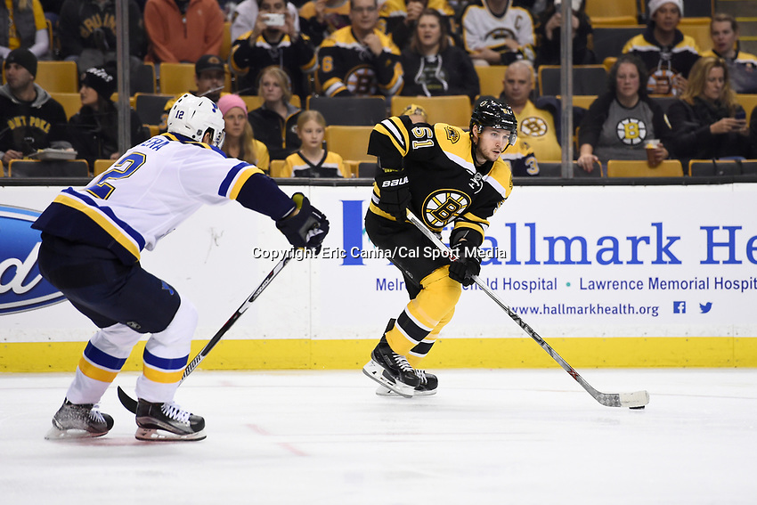 Tuesday, December 22, 2015: Boston Bruins center Ryan Spooner (51) and St. Louis Blues center Jori Lehtera (12) in game action during the National Hockey League game between the St. Louis Blues and the Boston Bruins held at TD Garden, in Boston, Massachusetts. The blues beat the Bruins 2-0 in regulation time. Eric Canha/CSM