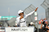 March 26, 2017: Lewis Hamilton (GBR) #44 from the Mercedes AMG Petronas team waves to the crowd during the drivers' parade lap at the 2017 Australian Formula One Grand Prix at Albert Park, Melbourne, Australia. Photo Sydney Low