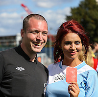 London, UK on Sunday 31st August, 2014. Amy Childs shows the referee the red card during the Soccer Six charity celebrity football tournament at Mile End Stadium, London.