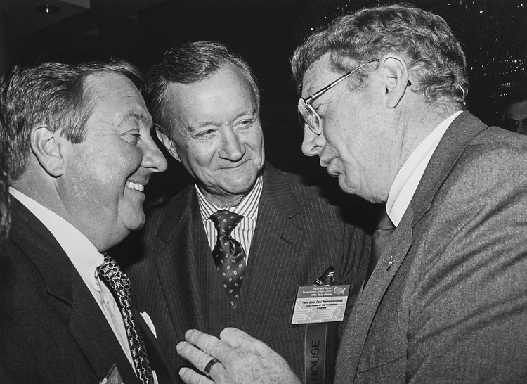 Sen. Conrad Burns, R-Mont., making a point as Rep. John Paul Hammerschmidt, R-Ark., and J. Ronald Reeves, USAir listen at a tourism industry dinner at Grand Hyatt on Feb. 6, 1991. (Photo by Maureen Keating/CQ Roll Call via Getty Images)
