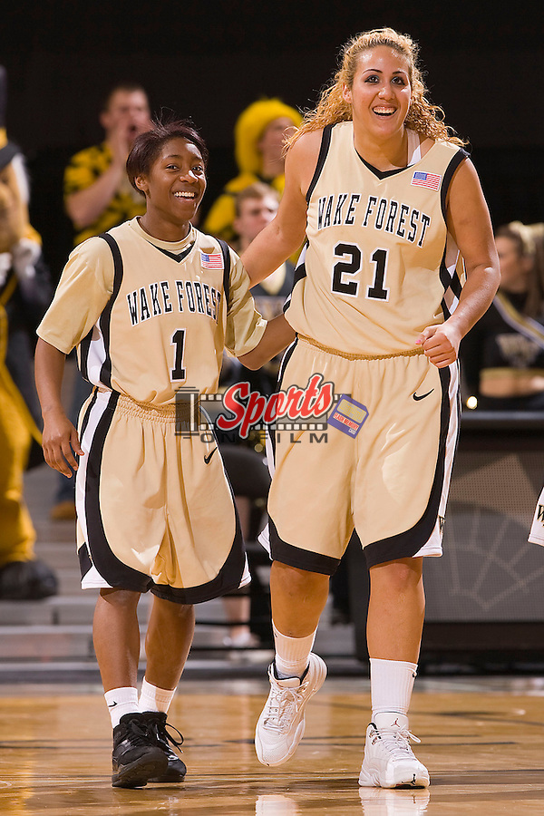 Brooke Thomas #1 and Sandra Garcia #21 of the Wake Forest Demon Deacons are all smiles as time winds down in their game against the Virginia Cavaliers at the LJVM Coliseum January 31, 2010 in Winston-Salem, North Carolina.  The Demon Deacons defeated the Cavaliers 64-57.  Photo by Brian Westerholt / Sports On Film