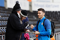 A Wigan Athletic player signs an autograph prior to the Sky Bet Championship match between Swansea City and Wigan Athletic at the Liberty Stadium, Swansea, Wales, UK. Saturday 19 January 2020