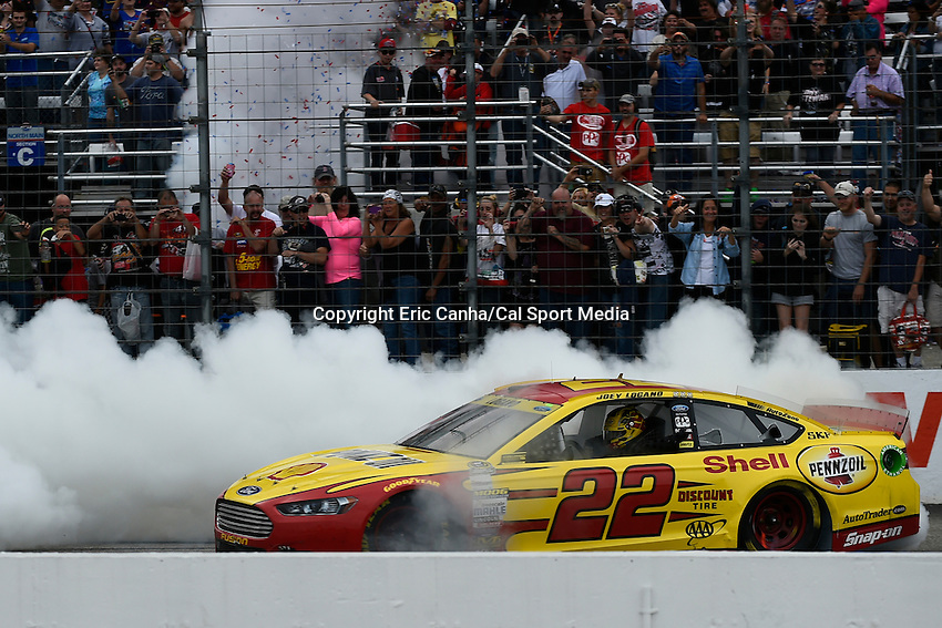 September 21, 2014 - Loudon, New Hampshire, U.S. - Sprint Cup Series driver Joey Logano (22) does a burnout after winning the Nascar Sprint Cup Series Sylvania 300 race held at the New Hampshire Motor Speedway in Loudon, New Hampshire.   Eric Canha/CSM