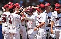 NWA Democrat-Gazette/CHARLIE KAIJO South Carolina players cheer on outfielder Carlos Cortes (8) after a score during the second game of the NCAA super regional baseball, Sunday, June 10, 2018 at Baum Stadium in Fayetteville. Arkansas fell to South Carolina 5-8.
