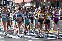 NEW YORK - NOVEMBER 7: The lead group of professional women, led by Christelle Daunay of France, approaches the 8 mile mark on 4th avenue in the 2010 New York City Marathon.  The race was won by Edna Kiplagat of Kenya, in the center of this group, in 2:28:20.
