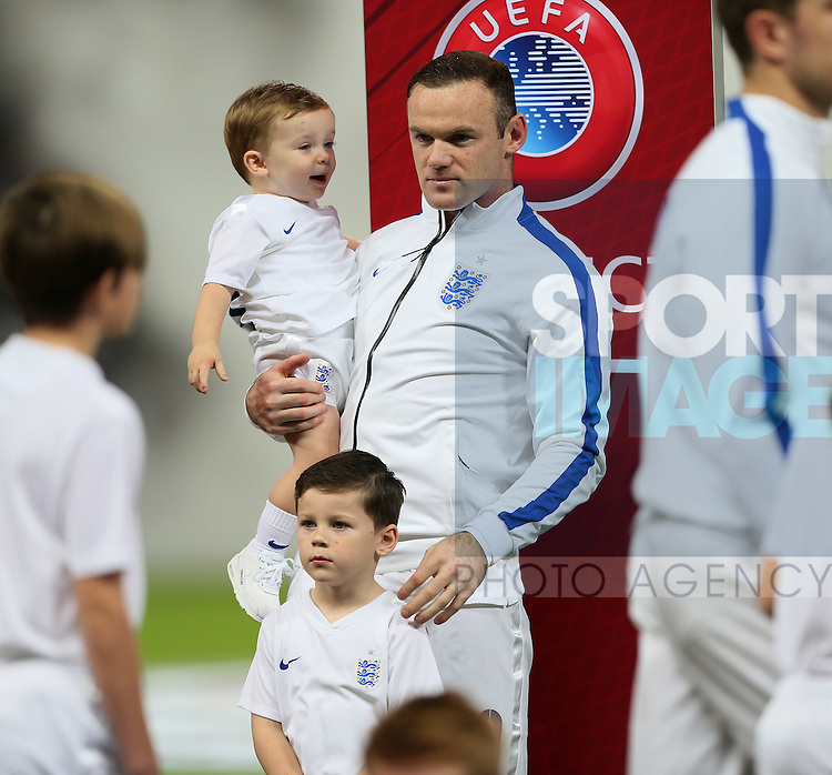 England's Wayne Rooney holds his sons Klay and Kai <br /> <br /> - International European Qualifier - England vs Slovenia- Wembley Stadium - London - England - 15th November 2014  - Picture David Klein/Sportimage