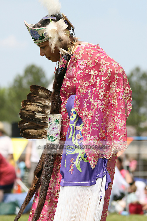 A Native American woman dances in full traditional regalia at the 8th Annual Red Wing PowWow in Virginia Beach, Virginia.