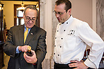 Sen. Charles Schumer, left, and executive chef Shannon Shaffer inspect a wine which will be served for the inaugural lunch on Friday, January 4, 2013 in Washington, DC.