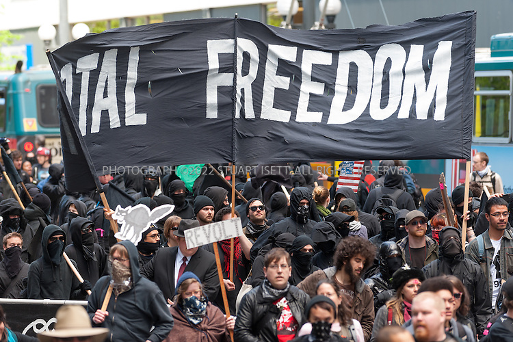 5/1/2012--Seattle, WA, USA..May Day protests in Seattle turned violent when a small faction of anarchists, clad in black, smashed banks and stores in downtown Seattle. Although the protest and rallies were mostly peaceful, they were marred by the attacks as well as attacks on reporters and photographers...©2012 Stuart Isett. All rights reserved.