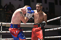 Youssef Khoumari (red shorts) defeats Michael Mooney during a Boxing Show at York Hall on 8th September 2018