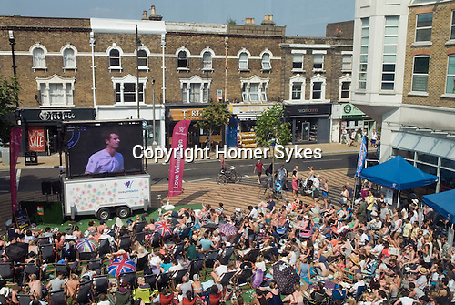 Wimbledon Market Square, crowds of people watch Mens Finals of Wimbledon tennis championships, Andy Murray. 2013