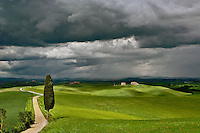 Road and storm clouds, rural Tuscany region, Itay