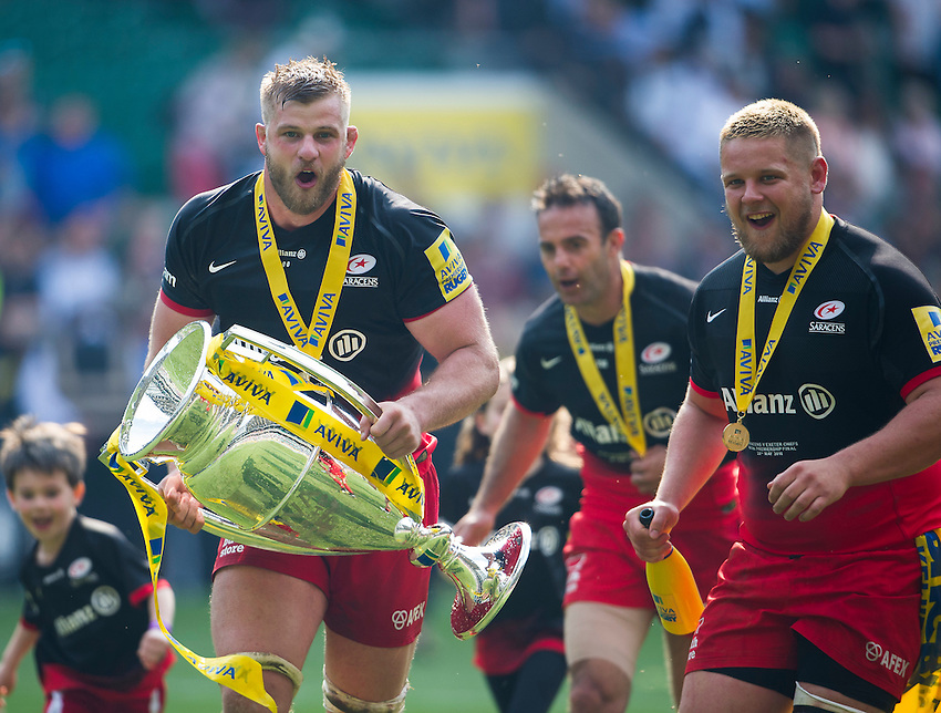 George Kruis of Saracens with the trophy after the 28-20 victory over Exeter Chiefs<br /> <br /> Photographer Ashley Western/CameraSport<br /> <br /> Rugby Union - Aviva Premiership Final - Saracens v Exeter Chiefs - Saturday 28th May 2016 - Twickenham Stadium, Twickenham, London  <br /> <br /> World Copyright &copy; 2016 CameraSport. All rights reserved. 43 Linden Ave. Countesthorpe. Leicester. England. LE8 5PG - Tel: +44 (0) 116 277 4147 - admin@camerasport.com - www.camerasport.com