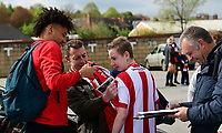 Lincoln City's Lee Angol signs autographs for fans as he arrives at the game<br /> <br /> Photographer Chris Vaughan/CameraSport<br /> <br /> Vanarama National League - Lincoln City v Macclesfield Town - Saturday 22nd April 2017 - Sincil Bank - Lincoln<br /> <br /> World Copyright &copy; 2017 CameraSport. All rights reserved. 43 Linden Ave. Countesthorpe. Leicester. England. LE8 5PG - Tel: +44 (0) 116 277 4147 - admin@camerasport.com - www.camerasport.com
