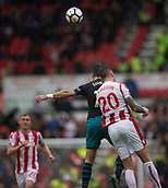 30th September, bet365 Stadium, Stoke-on-Trent, England; EPL Premier League football, Stoke City versus Southampton; Southampton's Shane Long and Stoke City's Geoff Cameron jump to head the ball